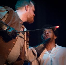 "Hubert threatens Arthur with a glowing hot poker in the Atlanta Shakespeare Company's ""King John"""