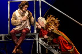 Richard II kisses Aumerle's hand in the Hudson Valley Shakespeare Festival's Richard II.