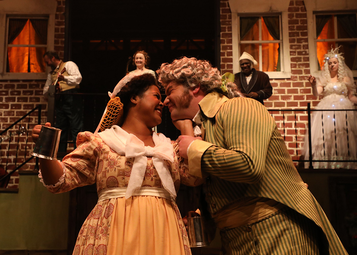 """A Christmas Carol"" at Chesapeake Shakespeare Company Gregory Michael Atkin and Tamieka Chavis as Mr. and Mrs. Fezziwig. Photo by Shealyn Jae."