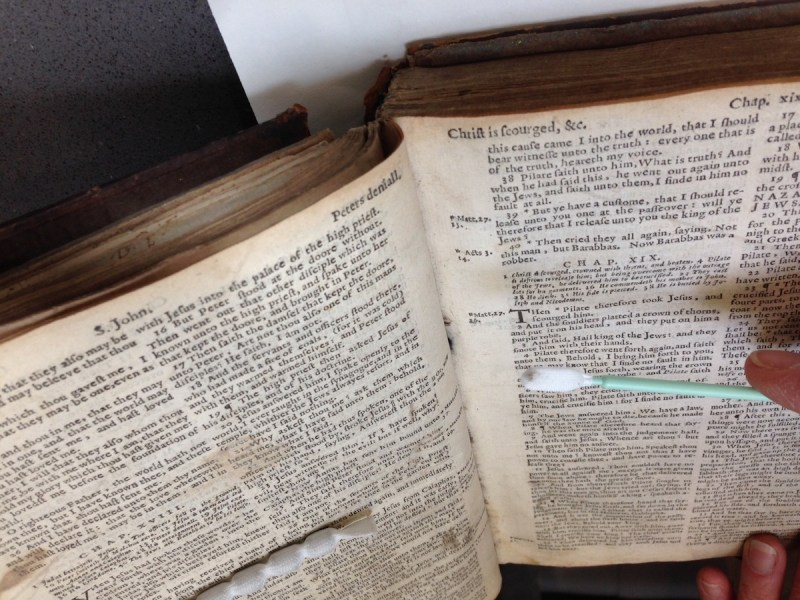 Sample of book dust being removed from 17th-century Bible, Folger Shakespeare Library.