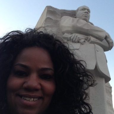 Debra Byrd in front of the Martin Luther King Jr monument in DC