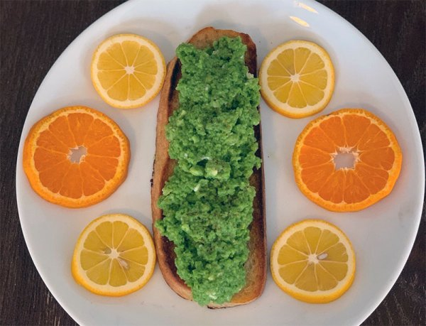 Spinach eggs on toast with lemon and orange garnish