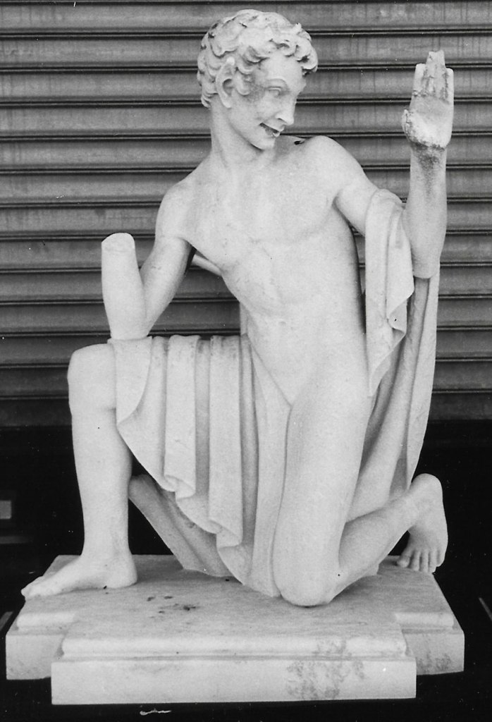 Puck statue missing a hand