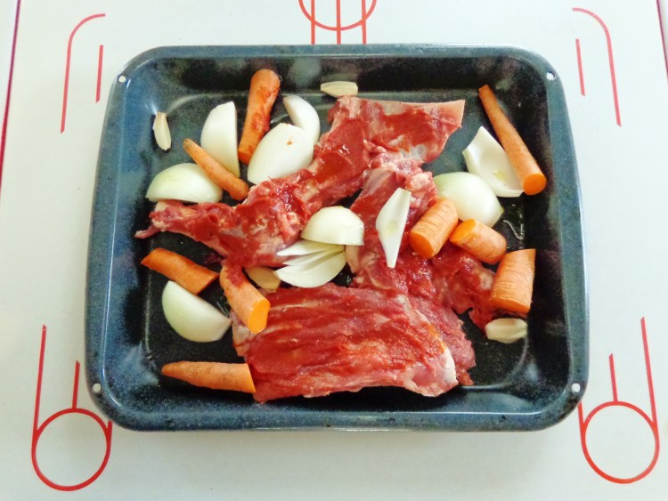 Roasting the lamb bones for stock on Shalavee.com
