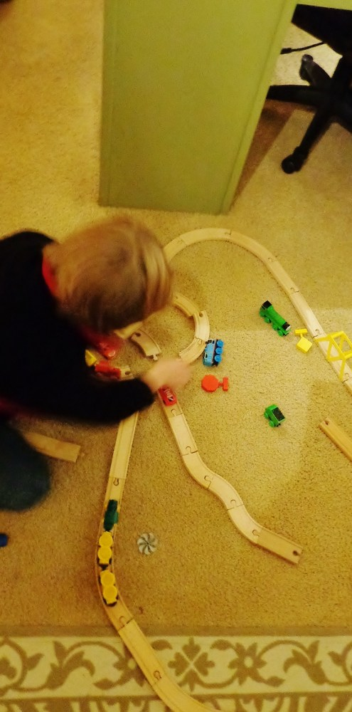Playing with the wooden trains on Shalavee.com