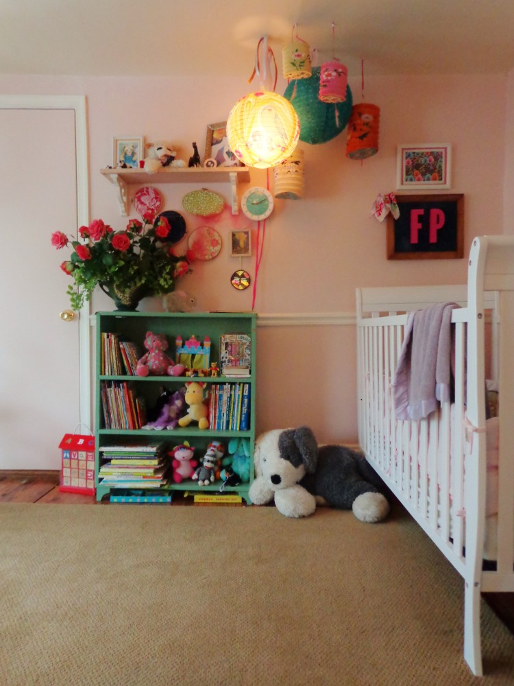 bookshelf and lanterns and crib in Fiona's bedroom on Shalavee.com