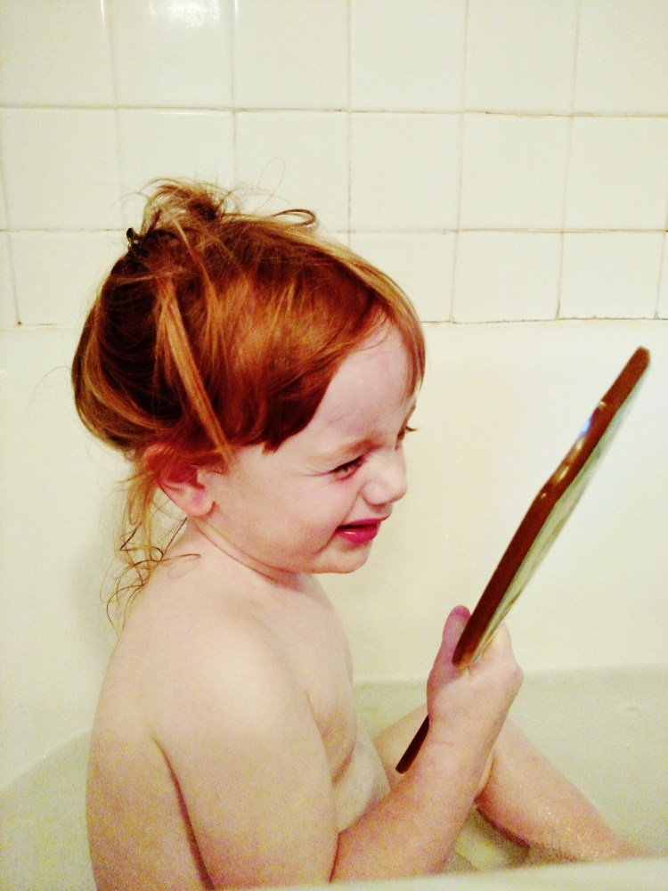 Fiona in the tub with a mirror