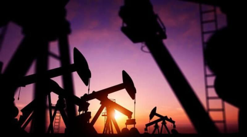 Shale Revolution: Oil Pumps at Dusk. Oil pumps producing oil at dusk.