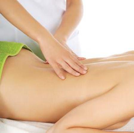 Beautiful woman lying on a massage table and has massage.