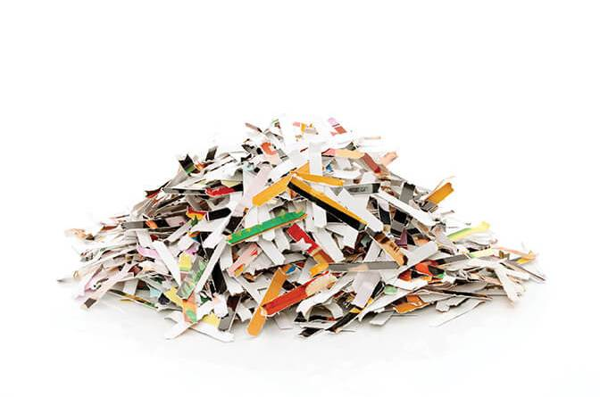 SHALE Oil & Gas Business Magazine: Don't Compromise Confidentiality. Shredded document paper on a white background