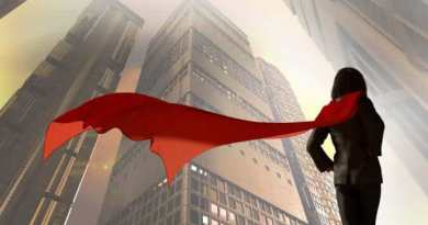 Women in Leadership Featured Article Shale Oil and Gas Business Magazine May June 2018 Issue - 3D Illustration of business woman dressed in a suit with a Cape superhero on the background of skyscrapers of the city