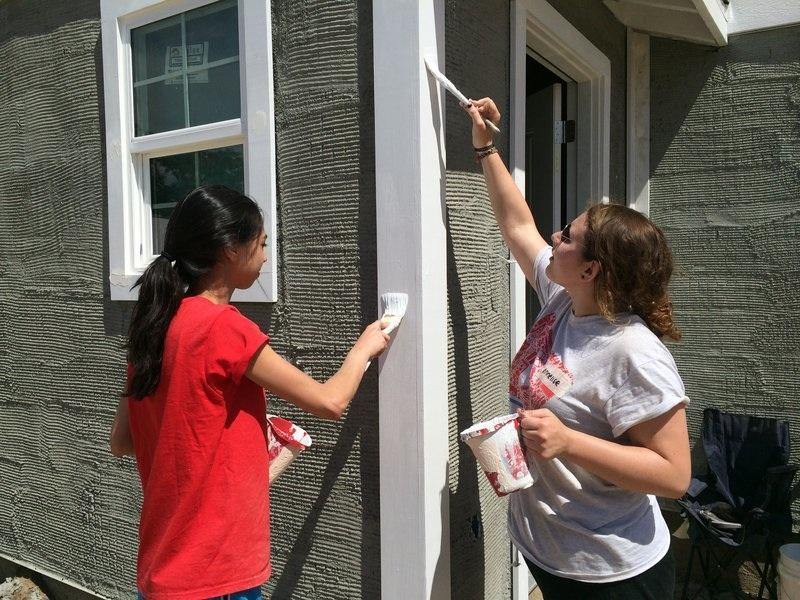 CHESED%3A+Seniors+Sarah+Soroudi+and+Annie+Asch+paint+a+Habitat+house+last+month.
