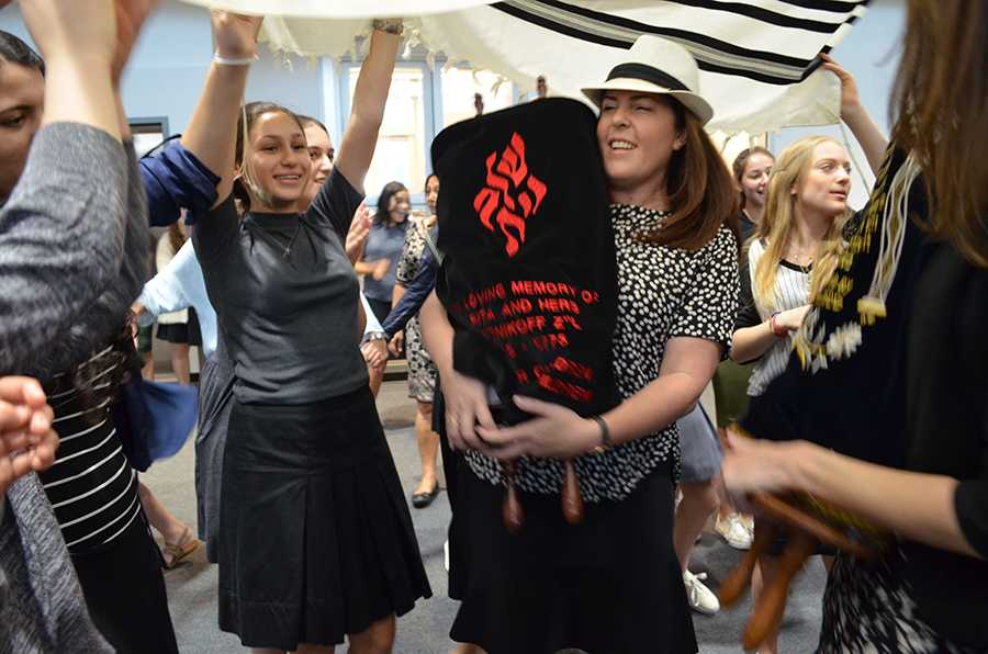 DANCE: Students celebrate with new Torah donated by Stacey Kent (center) and family after watching scribe Ronnie Siegar pen the last three words.