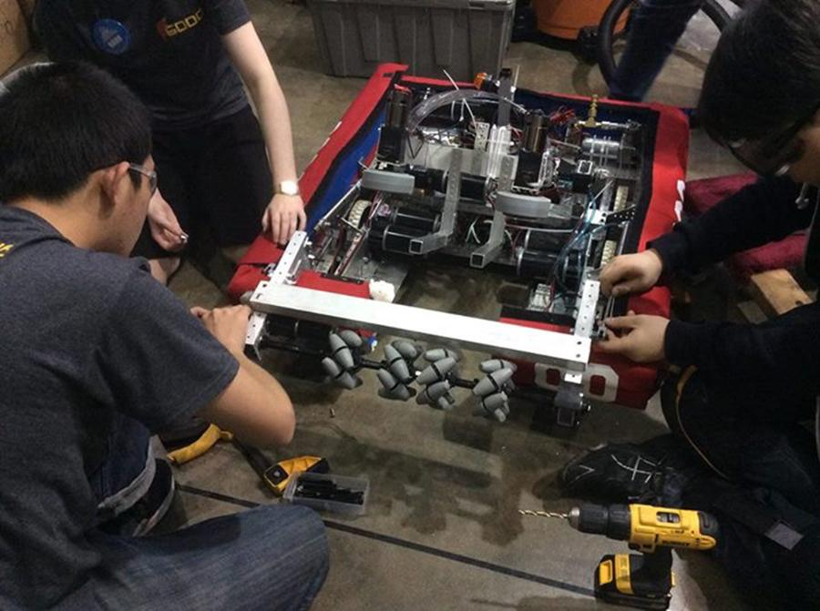 Team+members+perform+small+fixes+on+the+robot+in+preparation+for+an+FRC+match.+The+team+won+6+of+8+matches.+