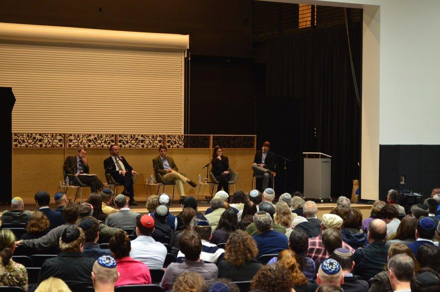 Hundreds+gathered+inside+the+gym+on+a+Saturday+night+to+hear+rabbis+agree+and+argue.+From+left%2C+Rabbi+Yosef+Kanefsky%2C+Rabbi+Pini+Dunner%2C+Rabbi+Adam+Kligfeld+and+Rabbi+Sharon+Brous%2C+with+Rabbi+Schwarzberg.