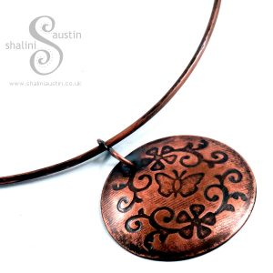'Flora' Embossed Copper Pendant on Torc Necklace