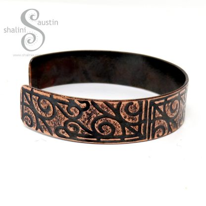 Copper Cuff with a pattern reminiscent of Henna Designs