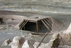 A reconstructed pit house.  In the desert they were often covered with brush.