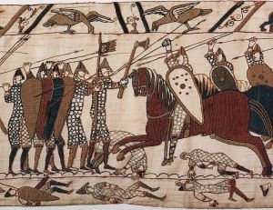 A section of the Bayeux Tapestry depicting the Battle of Hastings. The tapestry can be viewed in Bayeux, France.