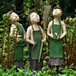 three statues singing in the garden