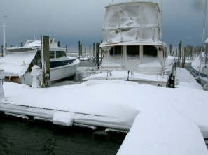 Our neighbor's boat with a cockpit full of snow