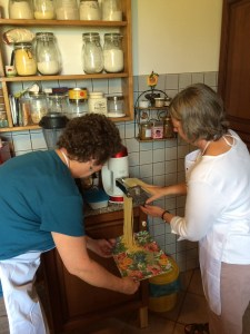 Nancy & Cathe work the pasta machine.