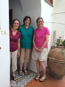 Shirley, Kristine, and Stormy pose at the door of the Casa Astarita.