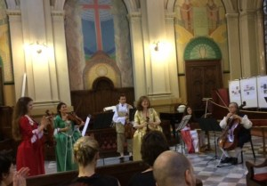 Musicians take a bow after performing Vivaldi. Notice the period costumes.