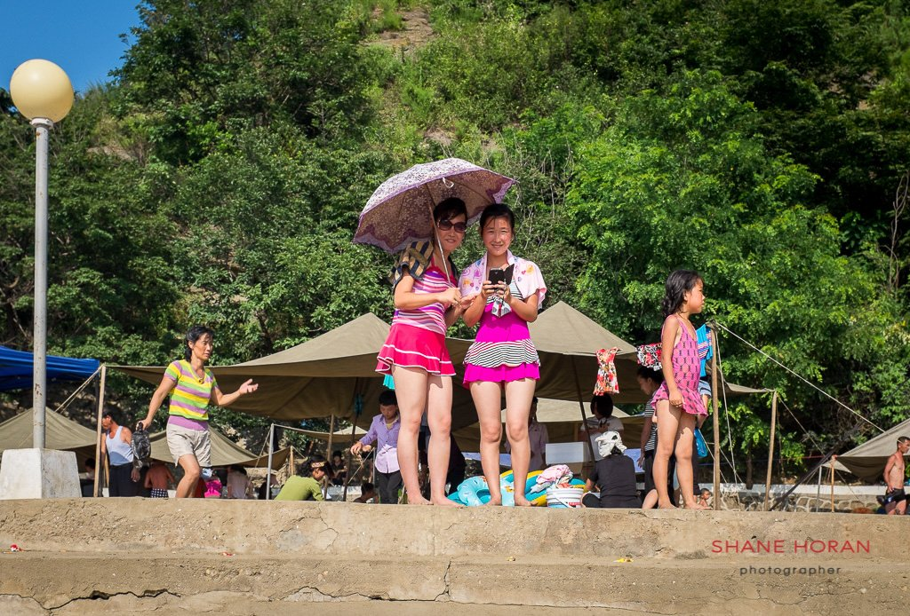Curios local onlookers at Nampo Beach, North Korea