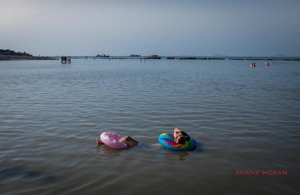 North Korean man relaxes at Nampo Beach, North Korea