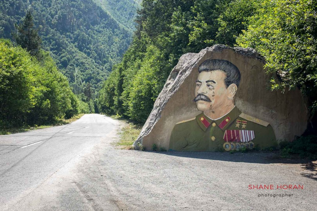 Josef Stalin keeps watch on a stretch of road between North Ossetia and South Ossetia. North Caucasus, Russia.
