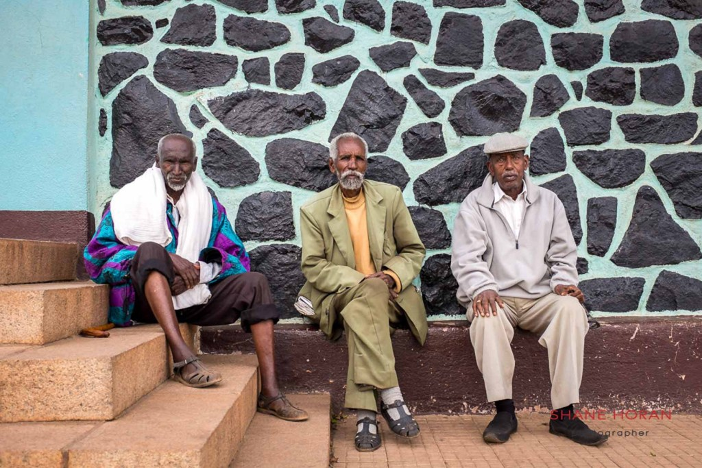 Italian speaking gents outside a church in Asmara, Eritrea