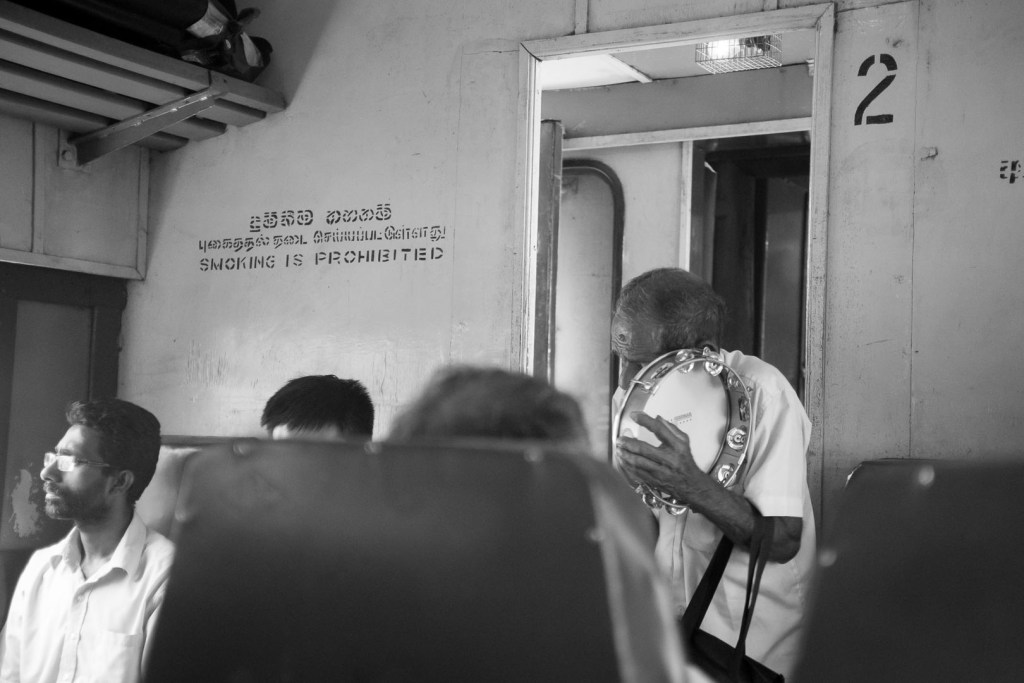 Busker on a train in Sri Lanka