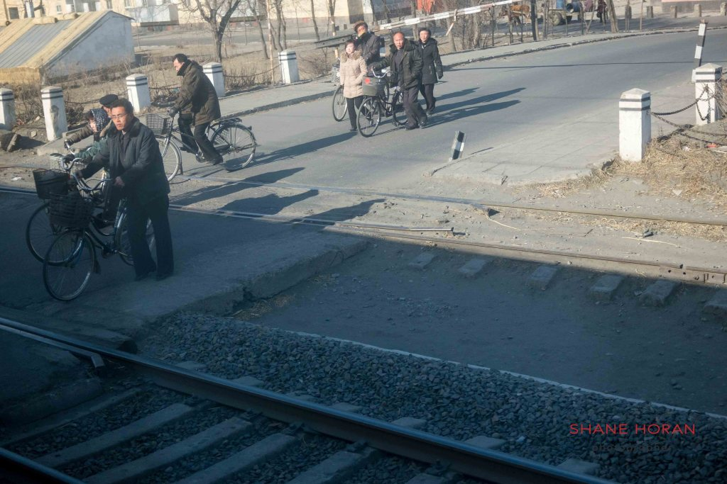 North Korea train passes a level crossing
