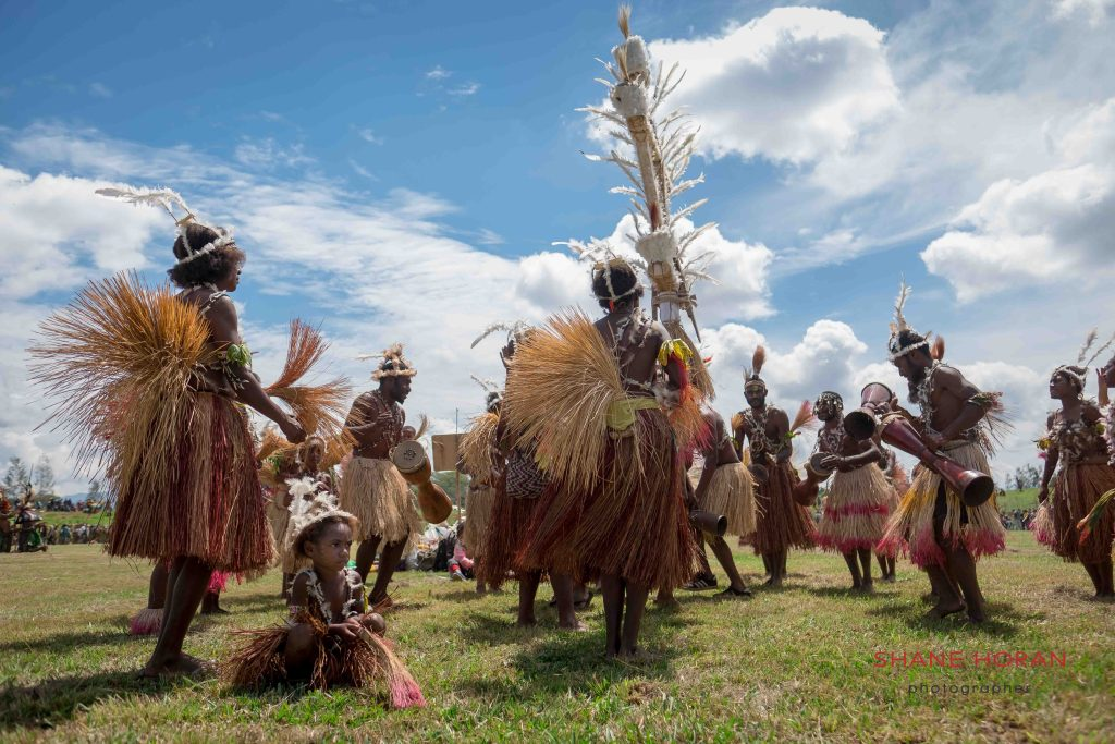 Tribe dances arounf a centerpiece, Papua New Guinea