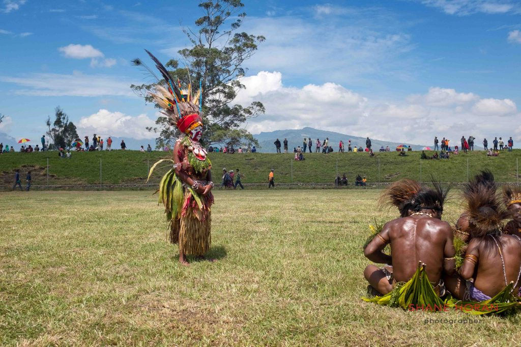 Another tribe watches on, Papua New Guinea
