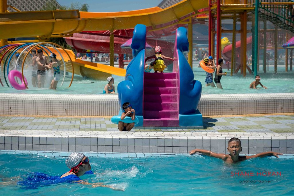 Chilling, Munsu water park, Pyongyang, North Korea.