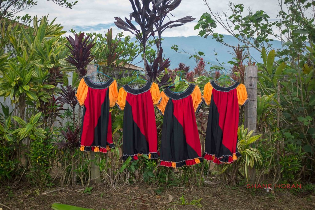 Papua New Guinea colured dress at a village.