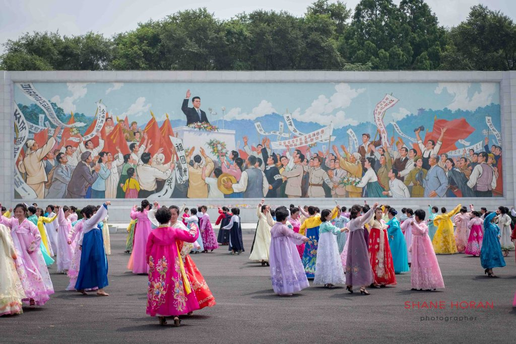Dancing near the Arch of Triumph, Pyongyang, North Korea
