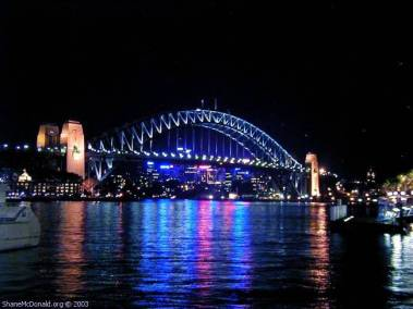 Sydney Harbour Bridge by Night, Sydney, Australia This is the world famous Sydney Harbour Bridge by night. The bridge was built in the 1930's and nicknamed the 'Coat Hanger' and the 'Iron Lung'.