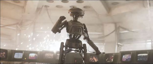star wars solo trailer droid in front of monitor screens 2