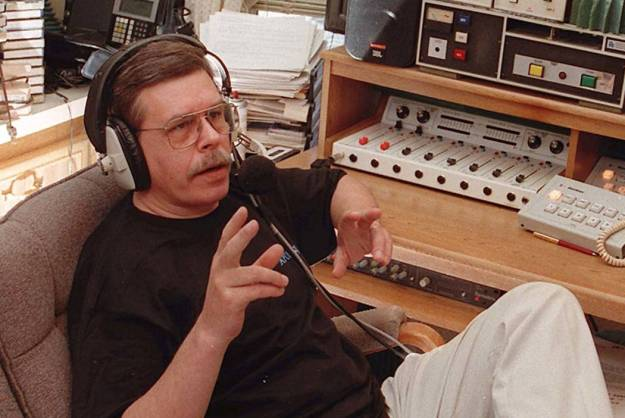 art bell talking with headphones on