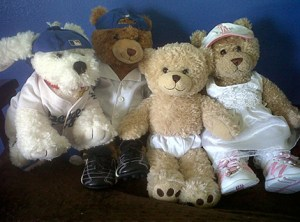 photo of 4 teddy bears in various sports uniforms