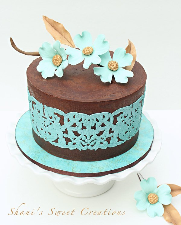 Teal lace and dogwood bloom cake