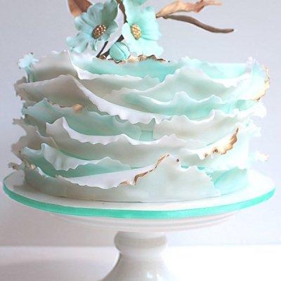 ruffled cake with dogwood flowers