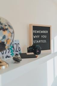 """A board that says """"Remember Why You Started."""" Its a reminder to keep going even when people don't support your business."""