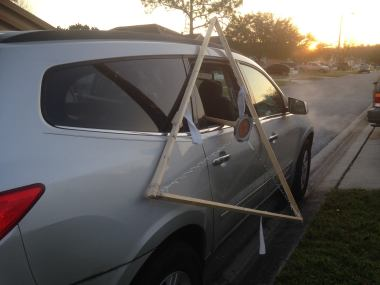 Yup, no matter how much you want it to, that is not going to fit inside of the car.