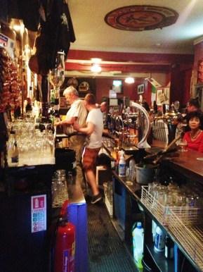 Tom and Tomas Mulligan, dancing behind the bar.