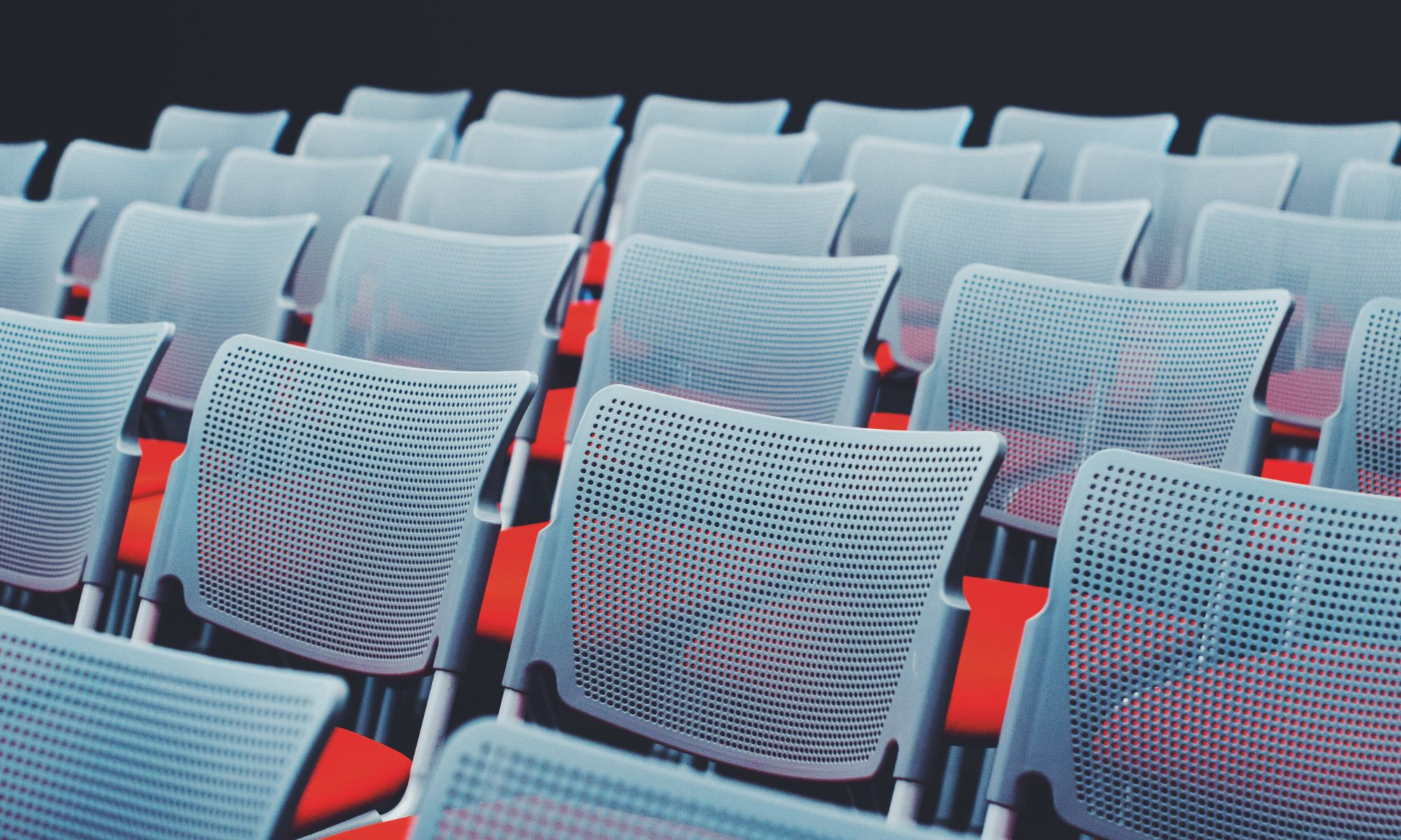 Empty Conference Chairs | Photo by ål nik on Unsplash
