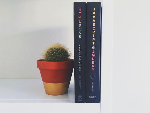 Web Design Books by Greg Rokozy | https://unsplash.com/photos/vw3Ahg4x1tY